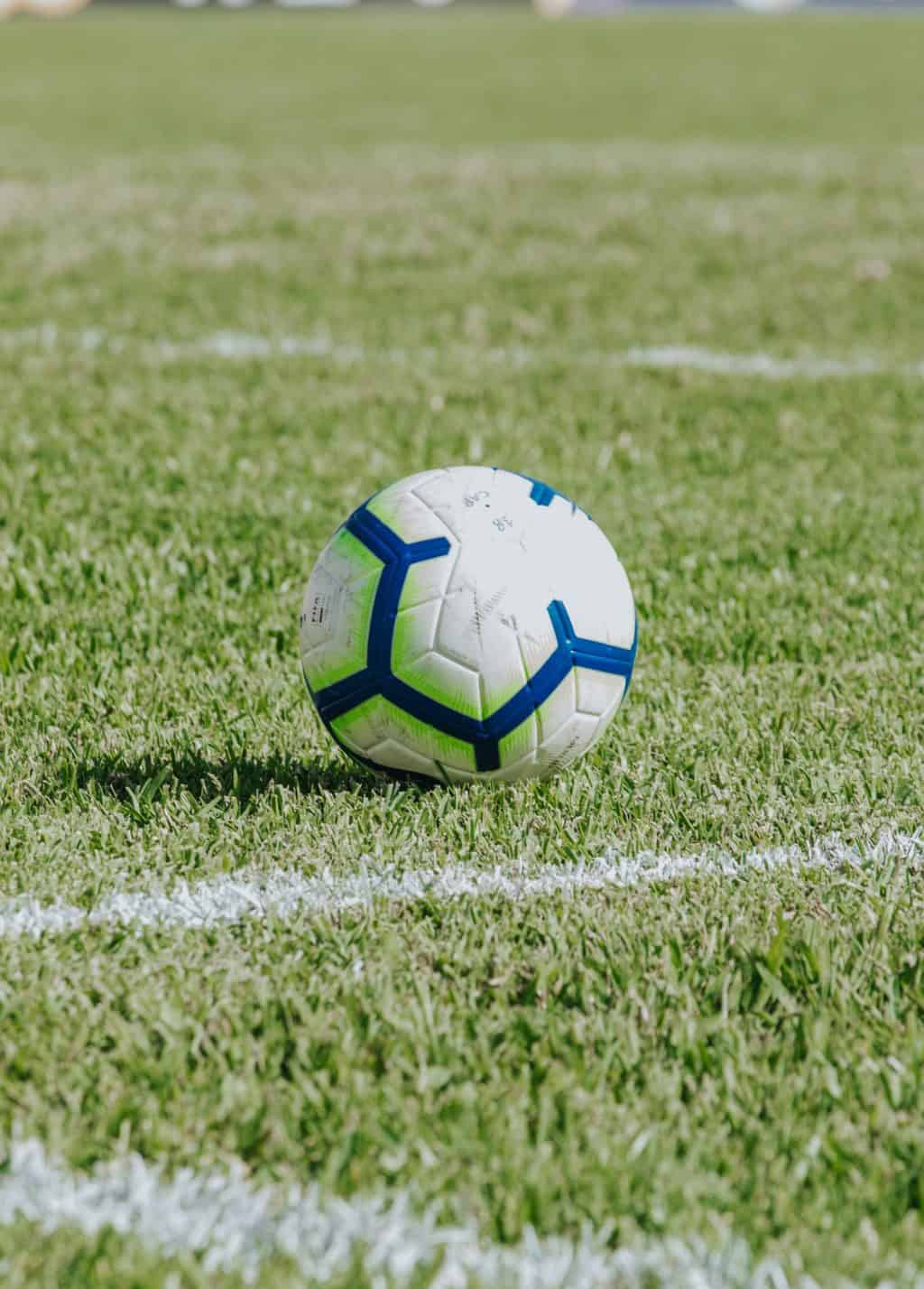 A soccer ball in the middle of the field