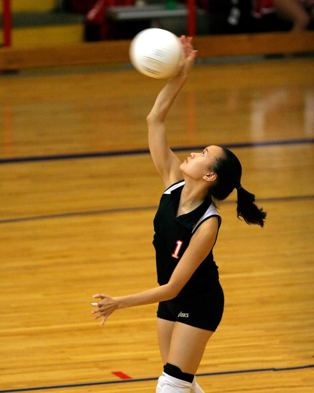 Volleyball player spiking a ball