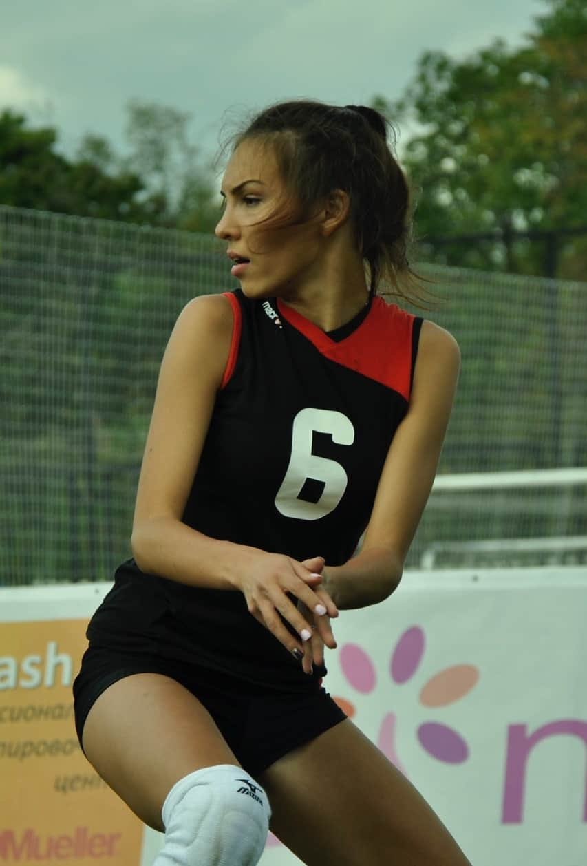 Woman in black and red volleyball attire