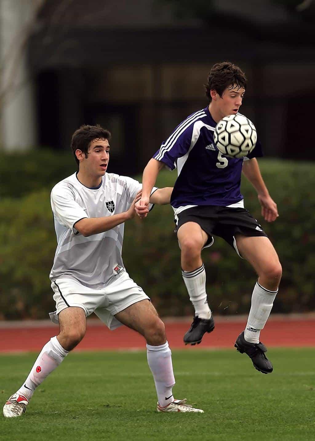 Two men playing soccer