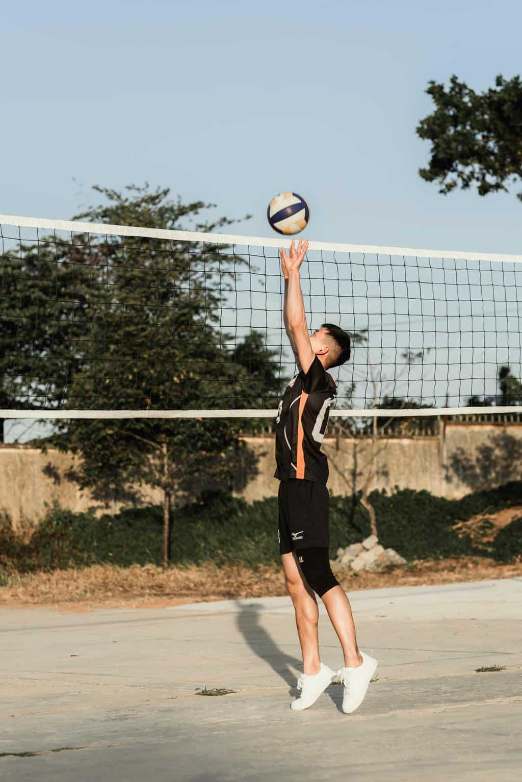 Man practicing volleyball