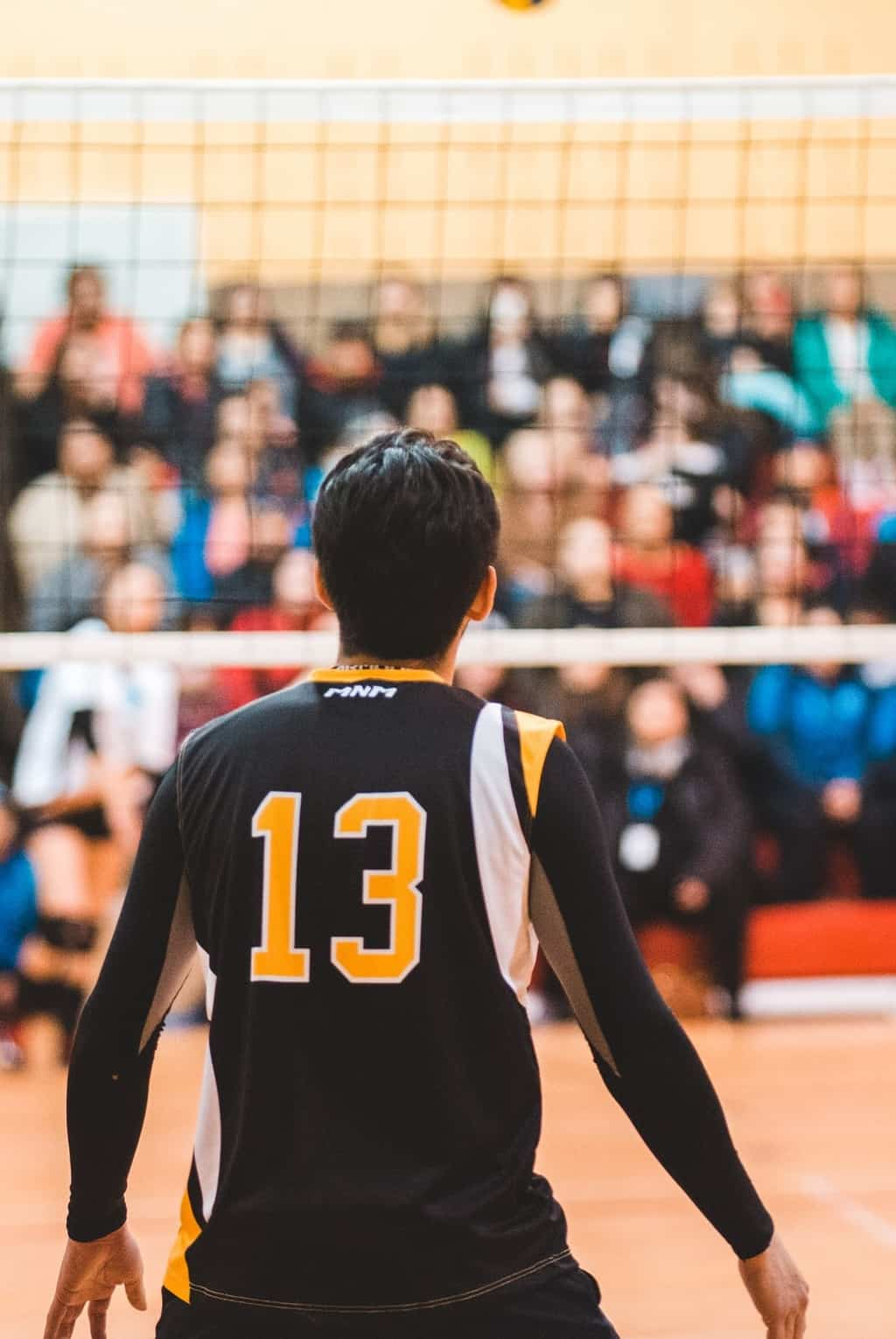 Volleyball player standing in court