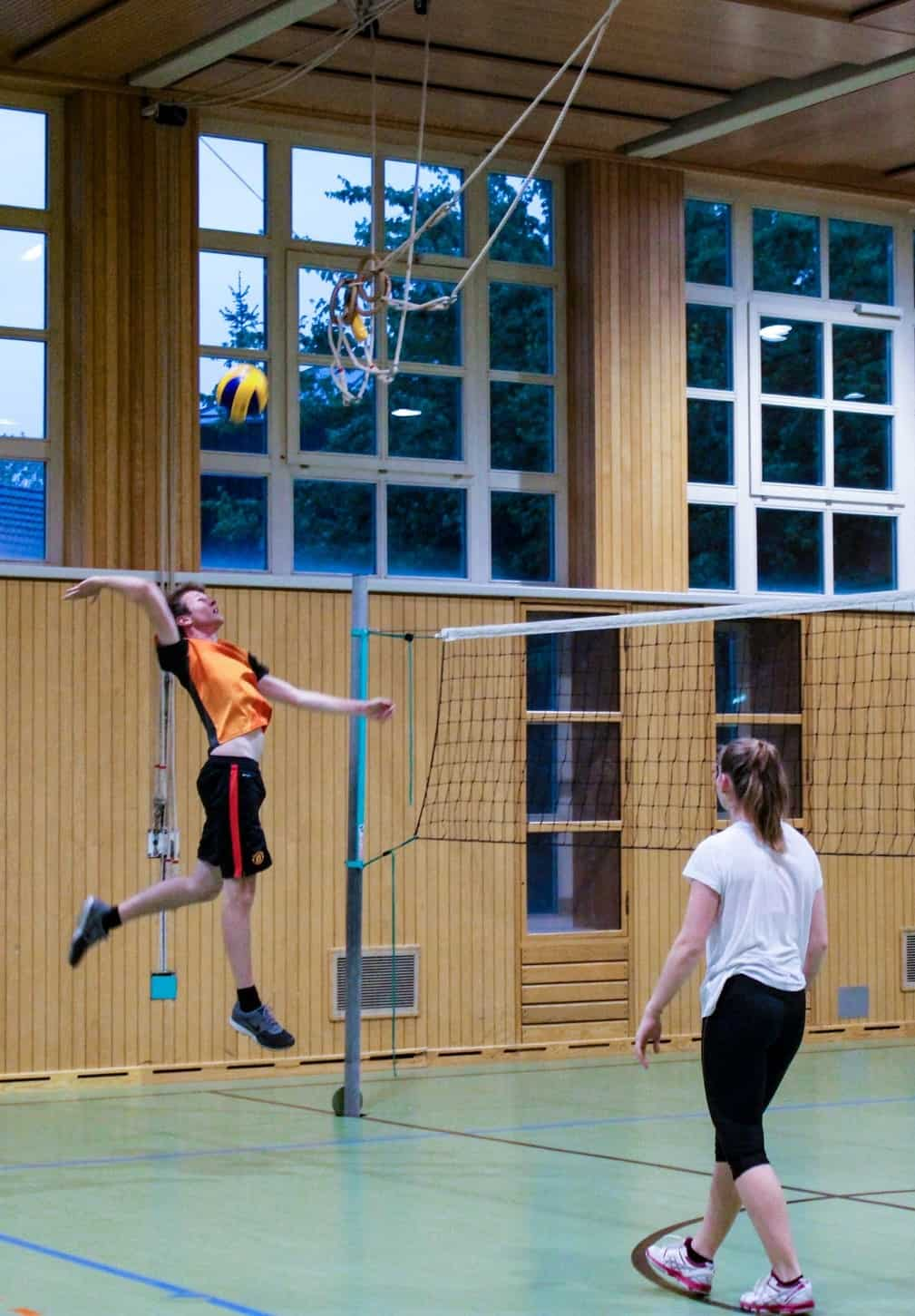 Player spiking a volleyball
