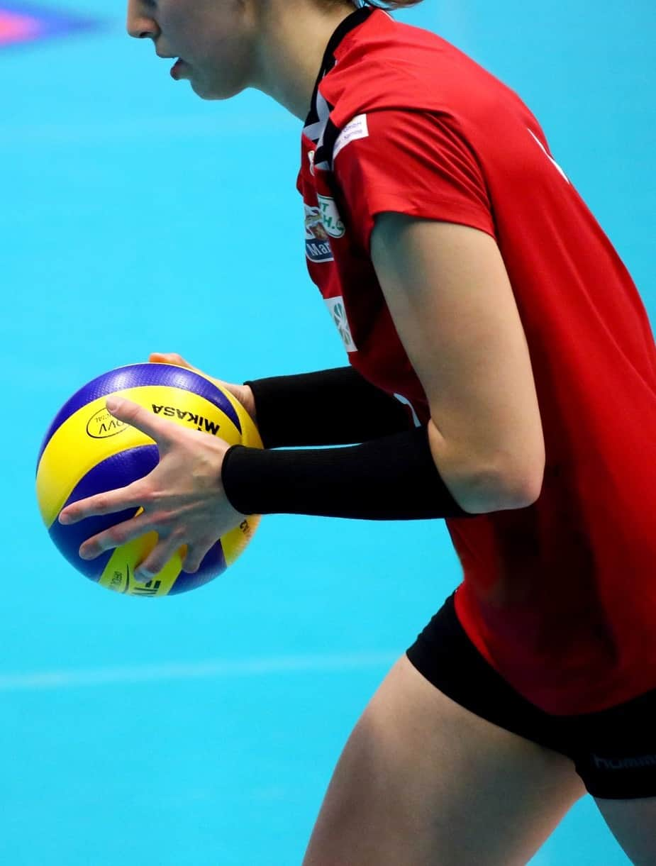 Volleyball player holding the ball