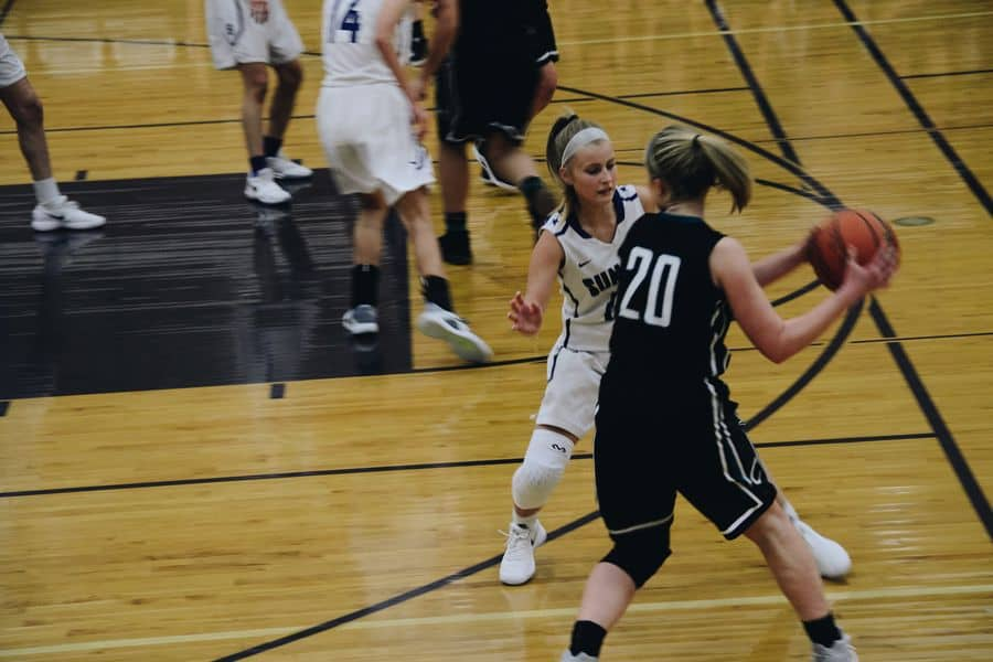 Woman wearing knee sleeves while playing basketball