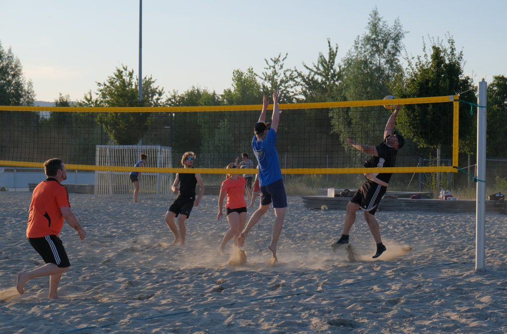 Volleyball players playing on sand