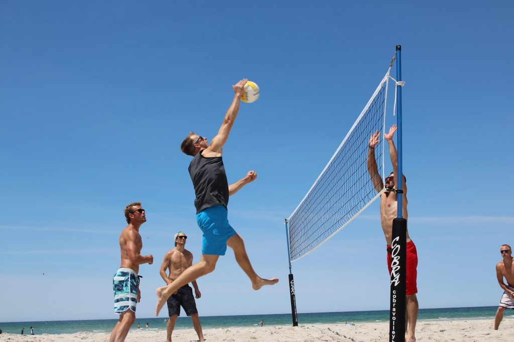 Beach volleyball with player about to spike