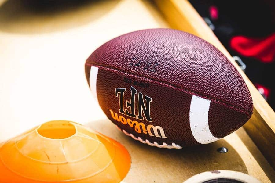 A football on a wooden surface