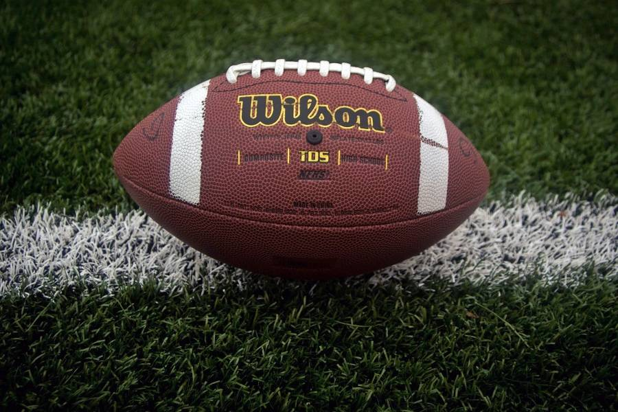 A football placed on a grass field