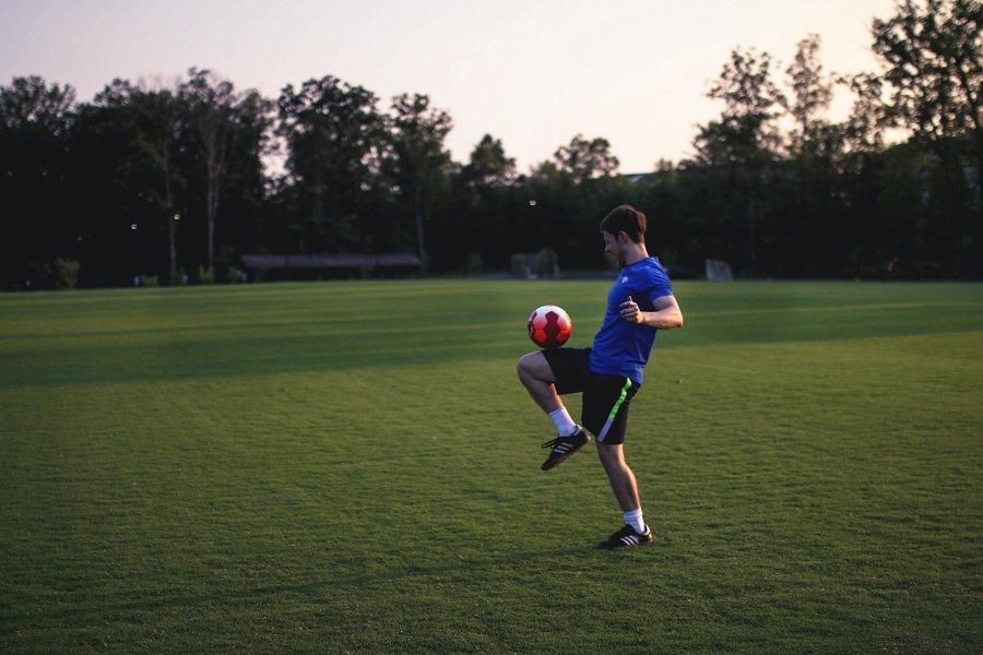 Man juggling a soccer ball