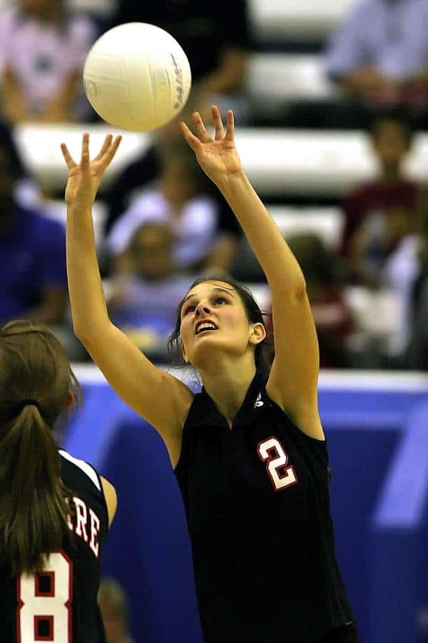 Volleyball player setting a ball during a match
