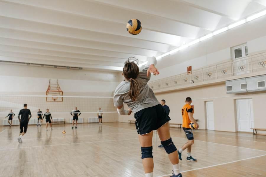 A volleyball player serving a ball