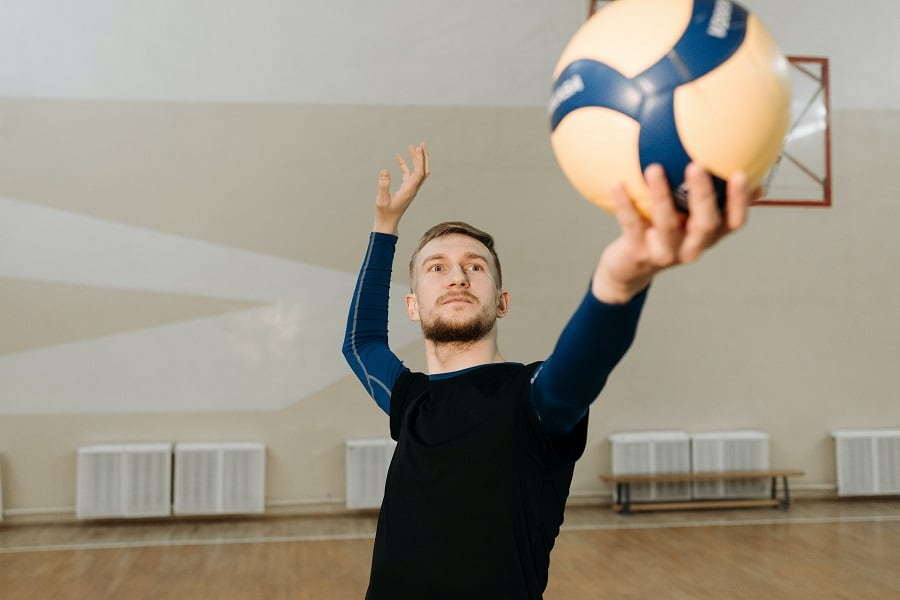 Volleyball athlete about to serve the ball