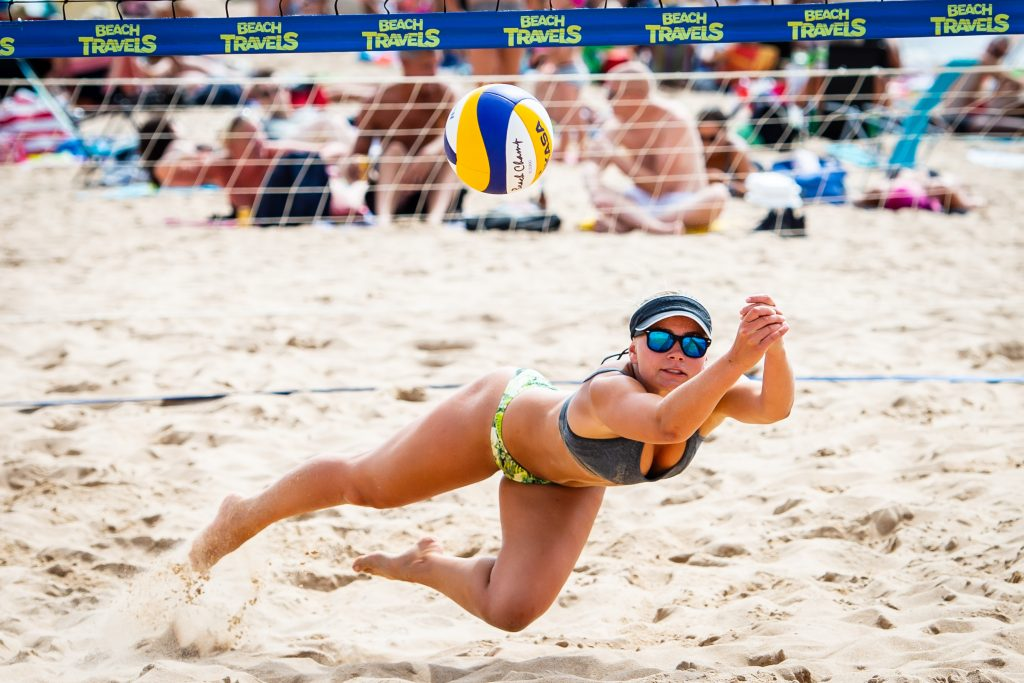 Beach volleyball player doing the dig