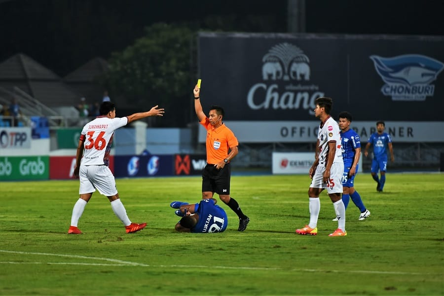 Soccer referee flashing a yellow card