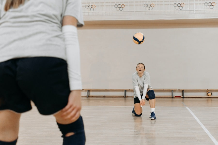 Volleyball player passing the ball to partner