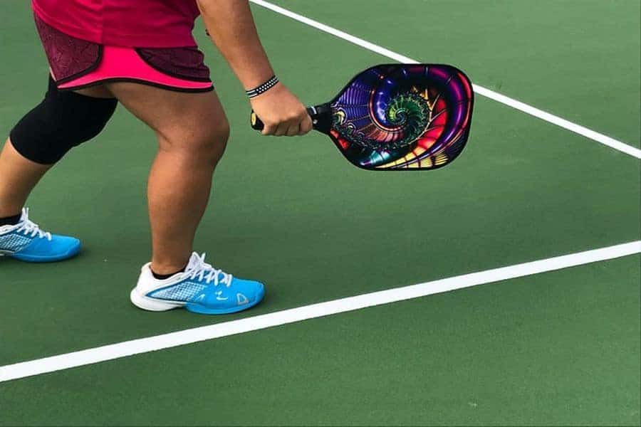 Person holding a pickleball paddle