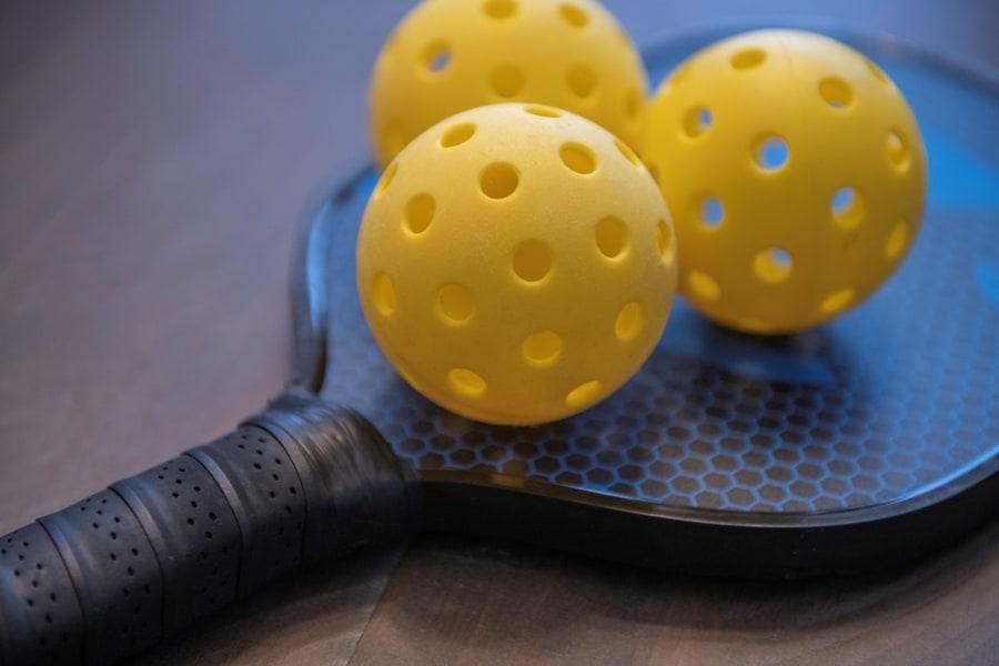 Pickleball paddle and three balls