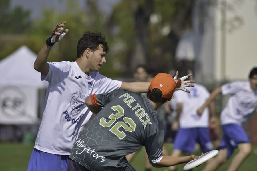 Player wearing gloves while playing ultimate frisbee