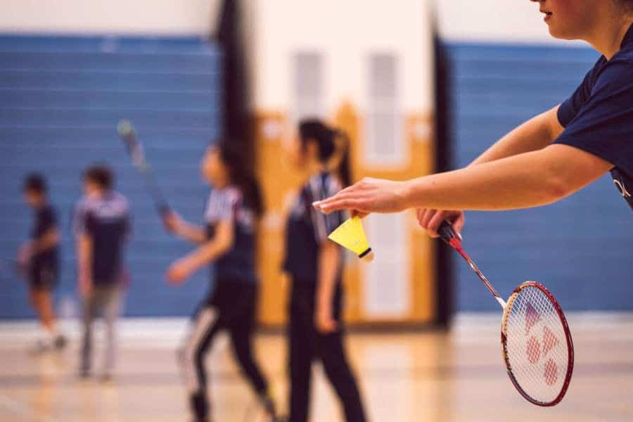 Player preparing to hit a shuttlecock